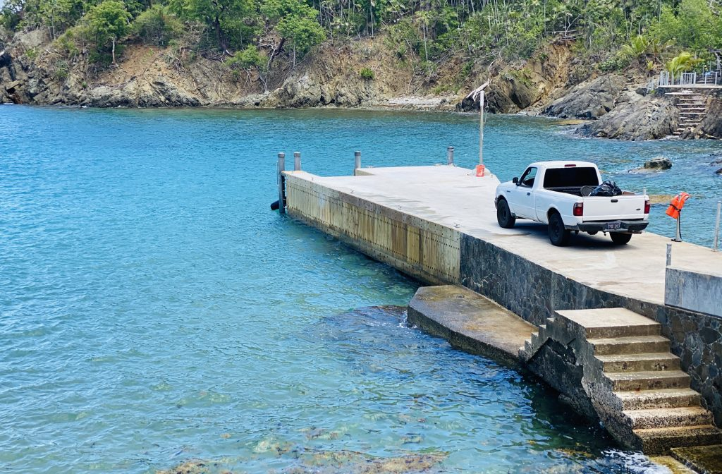 sugar bay dock with concrete seawall and steel pilings