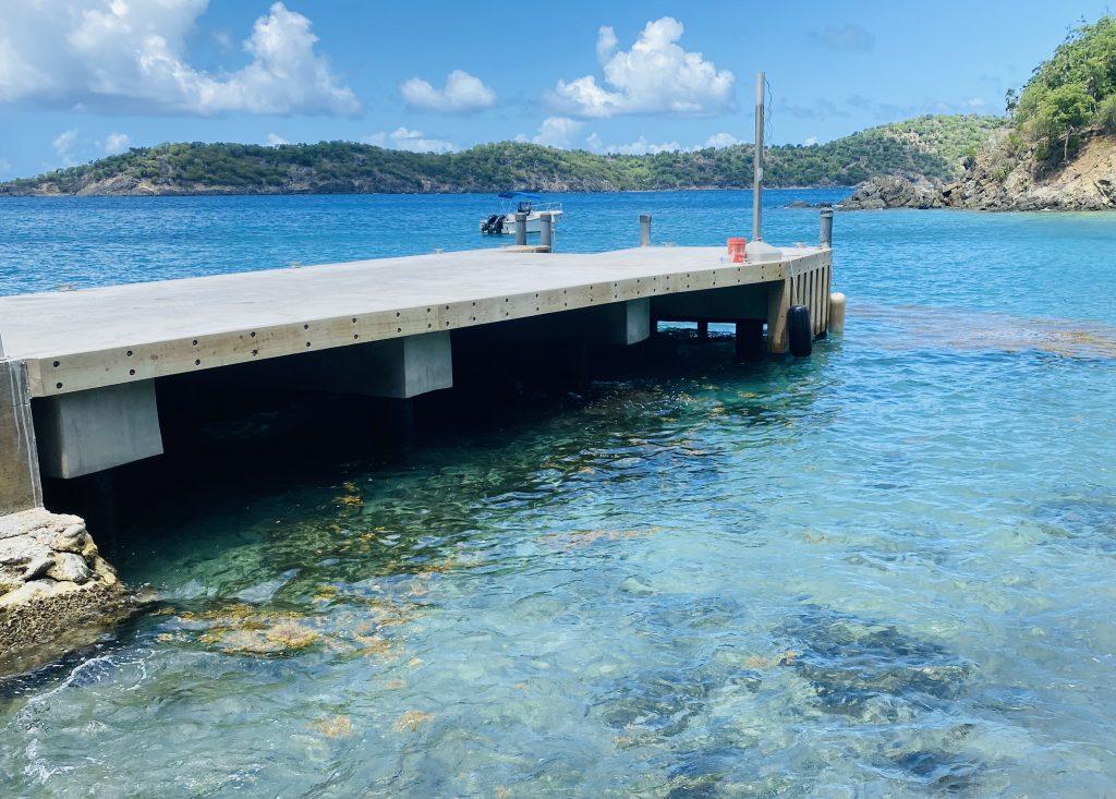 concrete dock w/ steel pilings